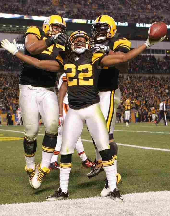 Pittsburgh Steelers teammates celebrate following a touchdown against the Cleveland Browns during the game on December 8 in Pittsburgh, PA.
