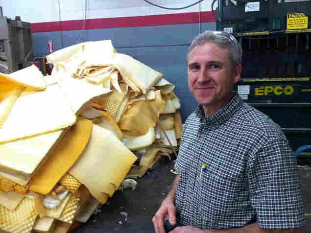 After months of practice, Ron Harness has the process of dismantling an old mattress down to a science.