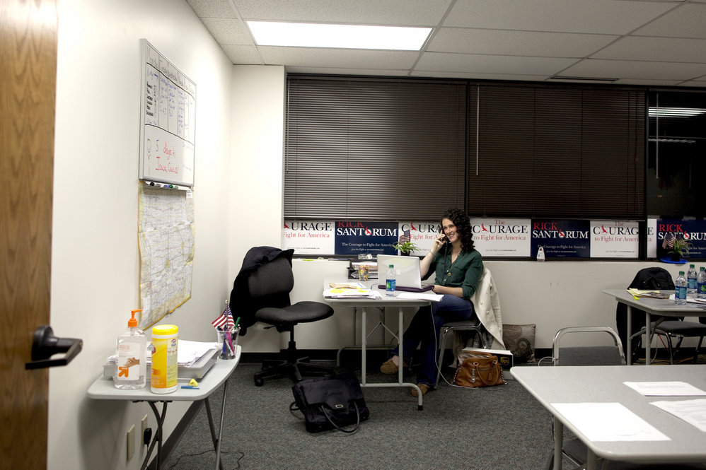 Santorum's daughter Elizabeth makes calls at his campaign headquarters, which was buzzing with activity when we arrived in the early evening.