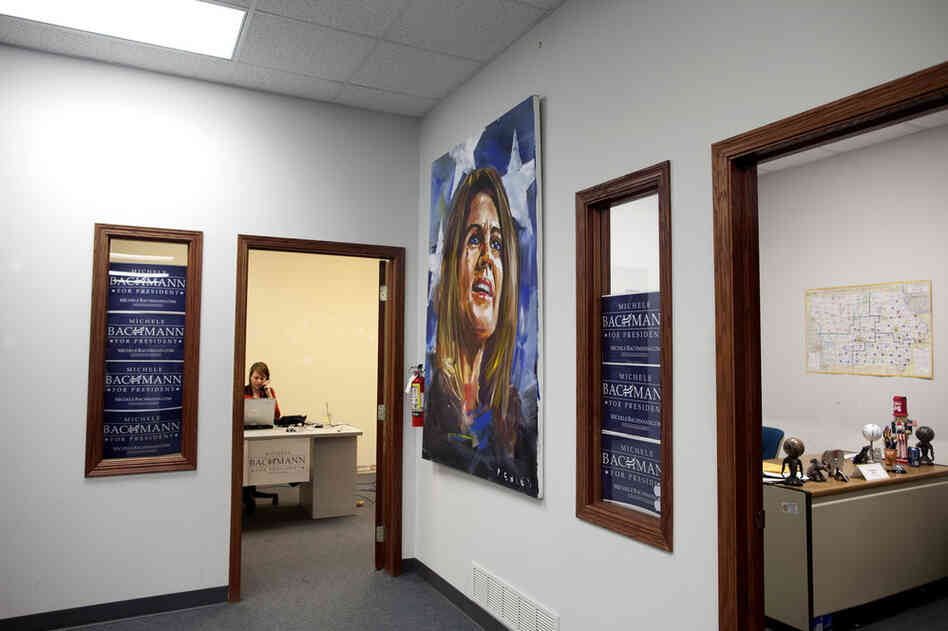 Michele Bachmann's campaign headquarters in the suburbs of Des Moines is located across the street from an empty Herman Cain office.