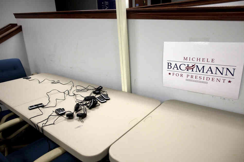 Scattered cellphones lay on a table at Bachmann's largely empty campaign headquarters.