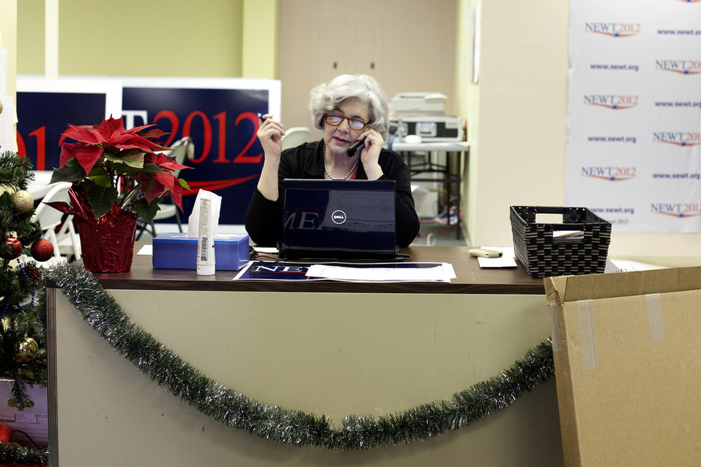 Volunteer Judy Reynolds answers calls at Gingrich's headquarters. Reynolds was one of a handful of volunteers there when we stopped by -- around the same time as Gingrich's first event in Des Moines.