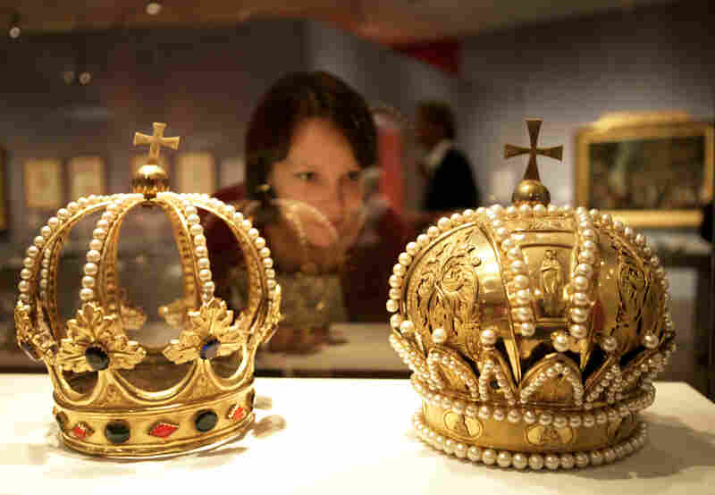 A woman inspects crowns of the Holy Roman Empire at a museum in Berlin. Much like that regime, the Bowl Championship Series is full of ornate pageantry — and also fails to live up to its name, Frank Deford says.