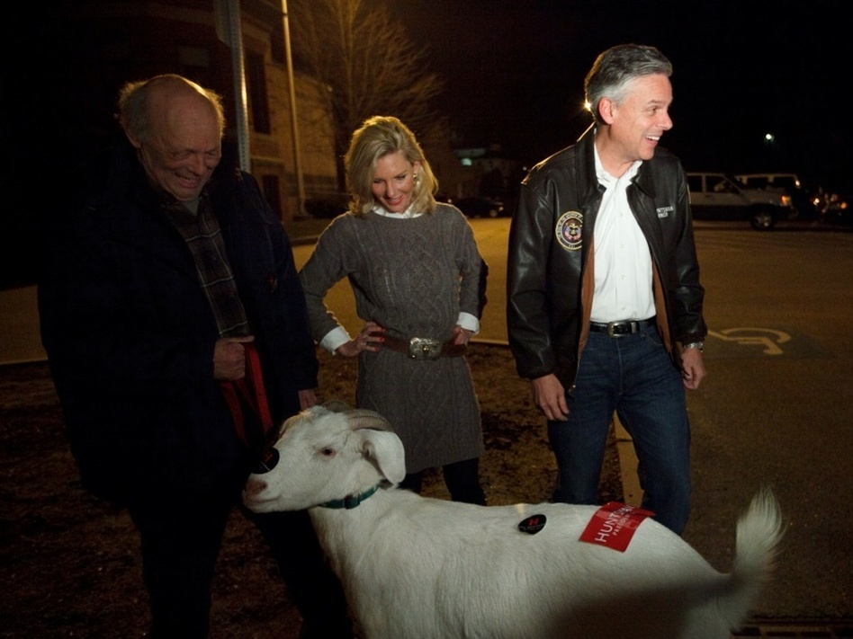 Huntsman may refuse to be the 'goat' of the GOP race, but he and his wife, Mary Kaye, did meet one named Izak and his owner, Bill Higgins, on Monday night outside the McConnell Community Center in Dover, N.H. (John W. Poole/NPR)