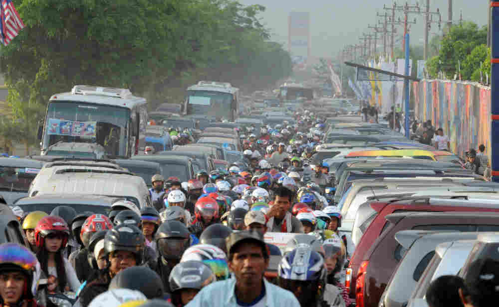 Motorists inch their way in heavy traffic in Palembang, Sumatra, in Indonesia. The nation's rapid growth is overwhelming its weak public infrastructure.