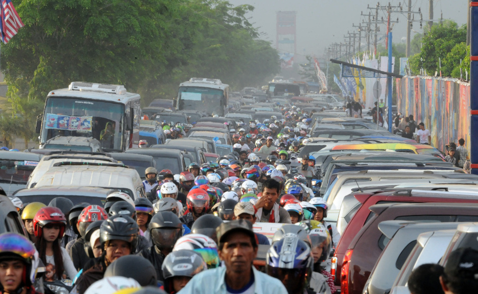 Motorists inch their way in heavy traffic in Palembang, Sumatra, in Indonesia. The nation's rapid growth is overwhelming its weak public infrastructure. (Ted Aljibe/AFP/Getty Images)