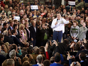Former Massachusetts Gov. Mitt Romney appeared at a rally Monday in Clive