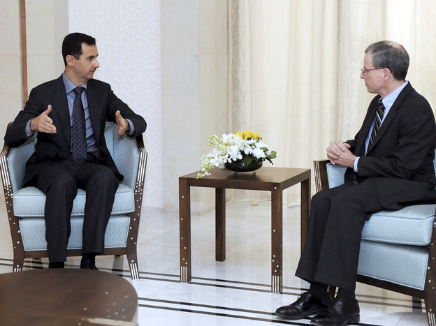 Syrian President Bashar Assad, shown meeting with U.S. Ambassador Robert Ford last January, blames the uprising in Syria on Islamic radicals.