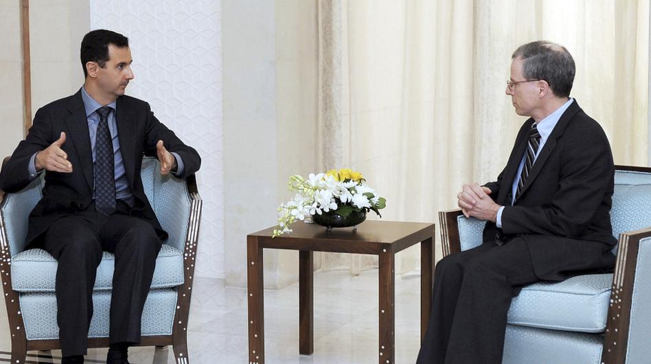 Syrian President Bashar Assad, shown meeting with U.S. Ambassador Robert Ford last January, blames the uprising in Syria on Islamic radicals.