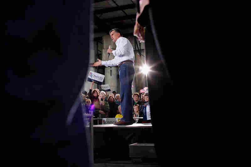 Former Massachusetts Gov. Mitt Romney addresses supporters during a campaign rally at the Weber Paper Company Monday in Dubuque, Iowa.
