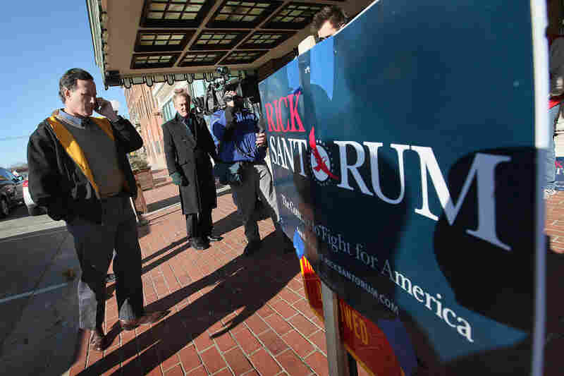 Former U.S. Senator Rick Santorum arrives for a campaign rally at the Hotel Pattee Monday in Perry, Iowa.