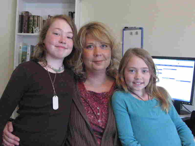 Sherrie Shackleford studies teaching at Western Governors University from her Indiana condo, where she lives with her daughters, Aubrey (left) and Alissa (right).