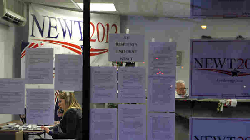 A volunteer works the phones Tuesday at Newt Gingrich's New Hampshire campaign headquarters in Manchester.