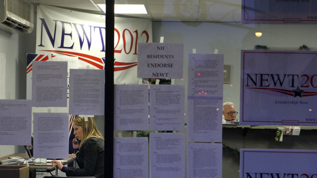 A volunteer works the phones Tuesday at Newt Gingrich's New Hampshire campaign headquarters in Manchester. (Getty Images)