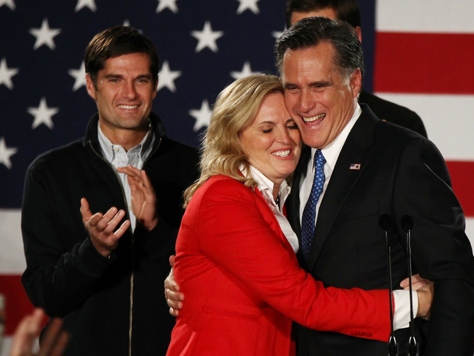 Republican presidential candidate Mitt Romney hugs his wife, Ann, in Des Moines, Iowa. (Win McNamee/Getty Images)