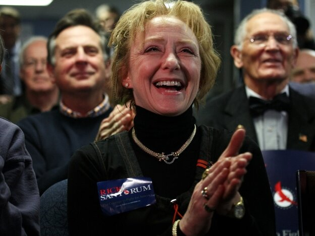 """Susan Carroll of Atkinson, N.H., reacts to news of a Santorum lead at a caucus-watching party at Santorum's New Hampshire campaign headquarters in Bedford. Carroll is the Santorum campaign's Tea Party liaison for the state and describes herself as the owner of a small business that offers """"artistic services."""""""