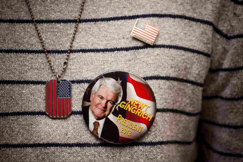 A Newt Gingrich supporter sports a campaign button at a town hall meeting in New York's Staten Island.
