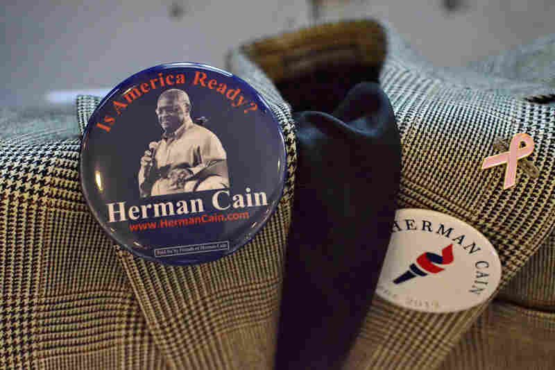 Campaign buttons for former Republican presidential candidate Herman Cain grace a supporter's jacket in Rock Hill, S.C., just before Cain ended his campaign.