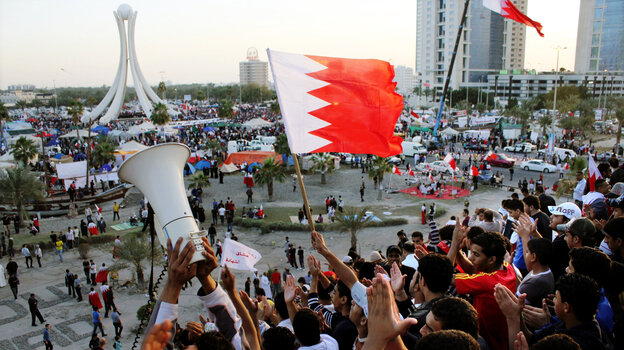 Bahrain is the one Arab country where the government has suppressed a major uprising. Here, protesters wave flags at the Pearl Roundabout in the capital Manama on Feb. 20, 2011, when the demonstrations were at their peak.