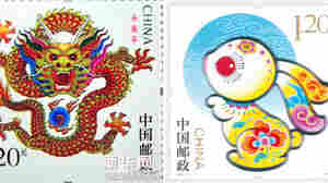 What A Difference A Year Makes: China's Year of the Dragon stamp, left, is decidedly more fearsome than last year's model, of a rabbit.