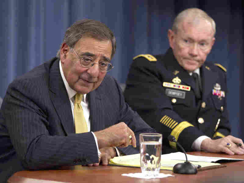 Defense Secretary Leon Panetta and Joint Chiefs Chairman Gen. Martin Dempsey take part in a news conference at the Pentagon in Washington in November 2011. The Obama administration is unveiling its new military strategy Thursday. Critics fear it could hamper the U.S. ability to fight two wars at once.