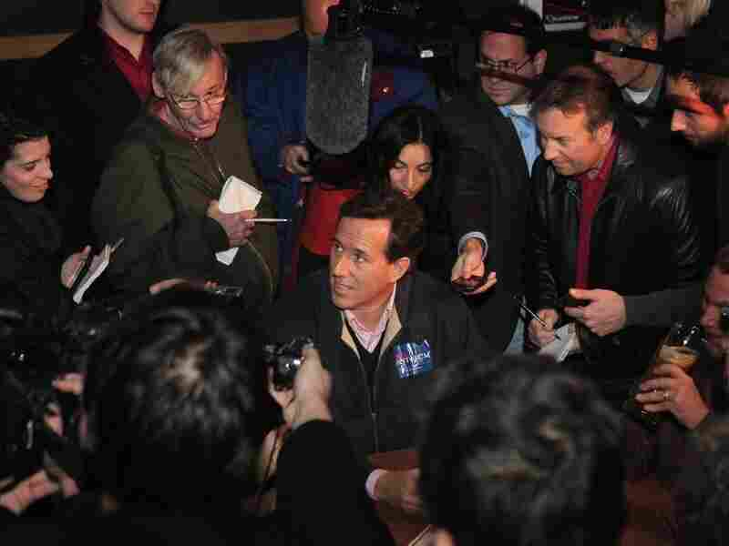 Republican presidential candidate and former U.S. Senator Rick Santorum is mobbed by press on Dec. 30 in Ames, Iowa.