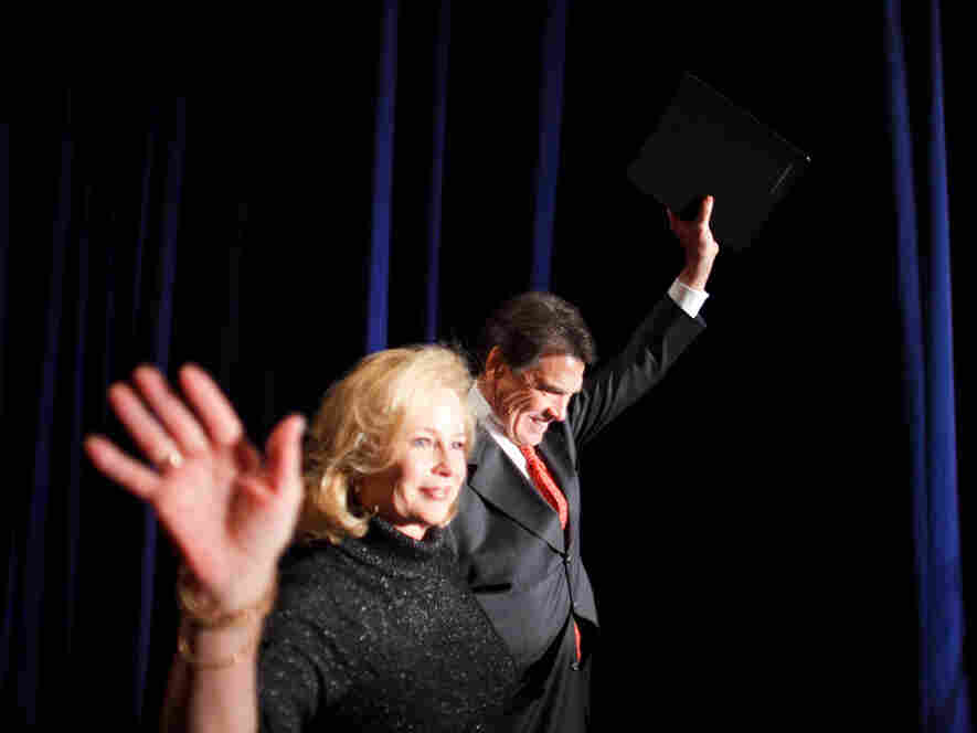 Texas Gov. Rick Perry and his wife, Anita, greet supporters after the Iowa caucuses.