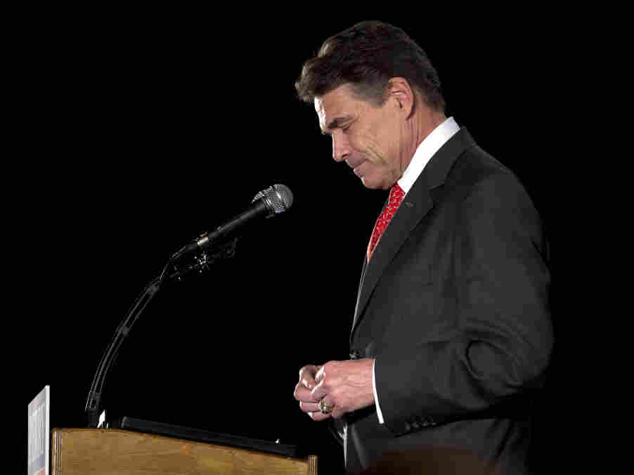 Texas Gov. Rick Perry said he's reassessing his presidential campaign after finishing a disappointing fifth in the Iowa caucuses.