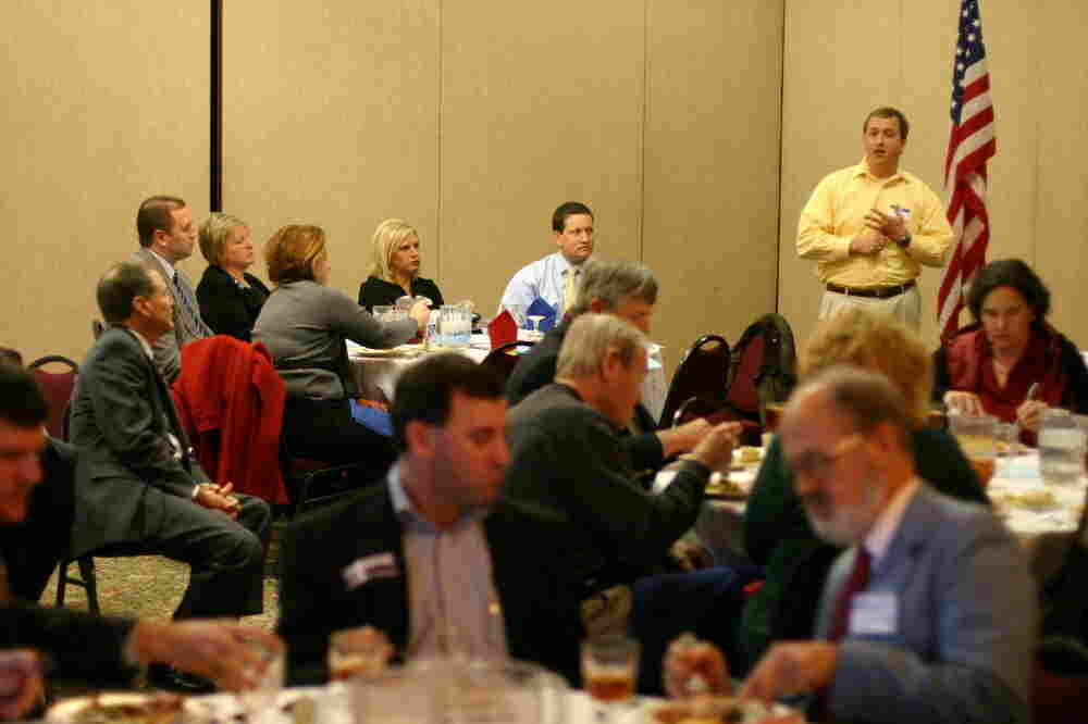 A surrogate makes the case for a GOP presidential candidate at a First Tuesday Republican Club lunch in Columbia, S.C., on Jan. 3.