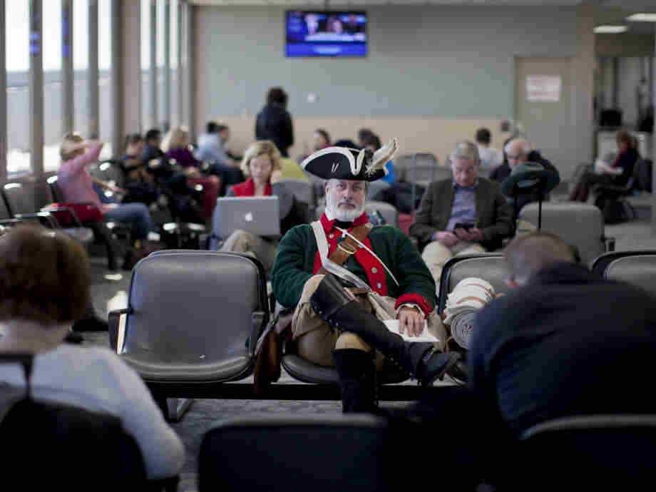Tea Partier William Temple of Brunswick, Ga., waits for a flight at Des Moines International Airport on Wednesday, a day after the Iowa caucuses.