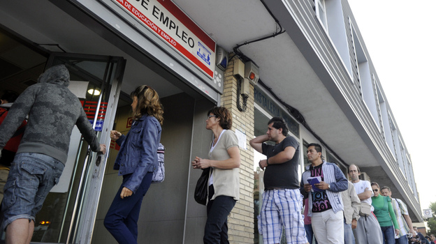 People wait in line at a government employment office in Madrid. (AFP/Getty Images)