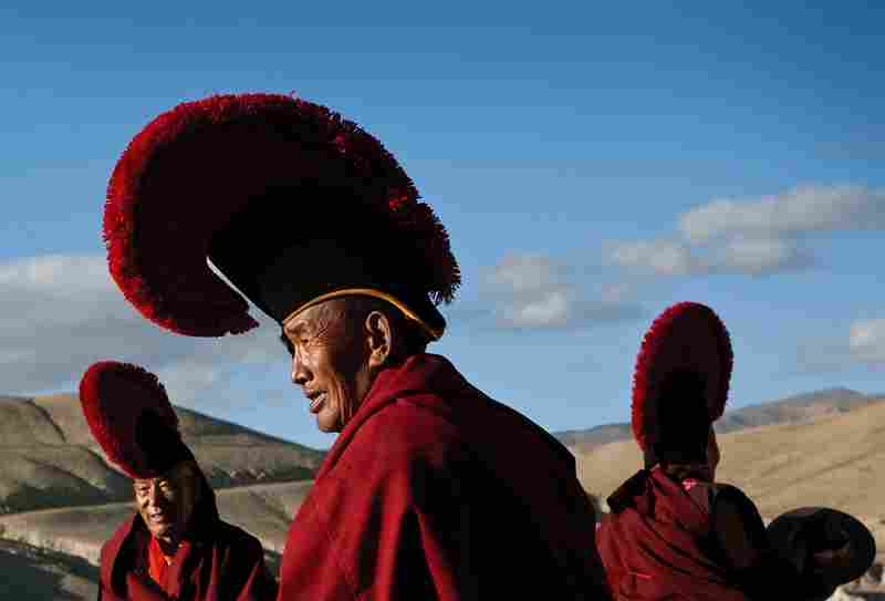 A group of senior monks prepare for a ceremony during one of Lo Manthang's many festivals.