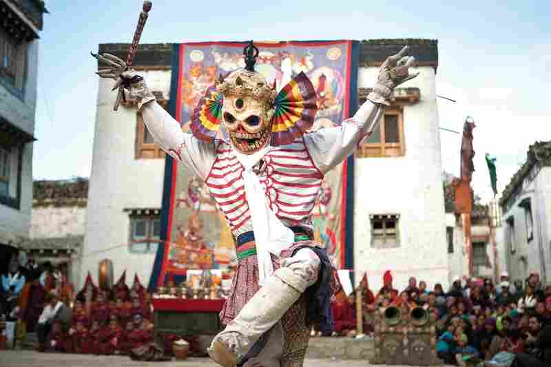 During the three-day spectacle of the Tiji festival, monks dress as different animals, demons and divinities to enact an epic fight between good and evil. In the town square of Lo Manthang, a monk dressed as a skeleton performs an ancient dance accompanied by ceremonial Tibetan Buddhist music.
