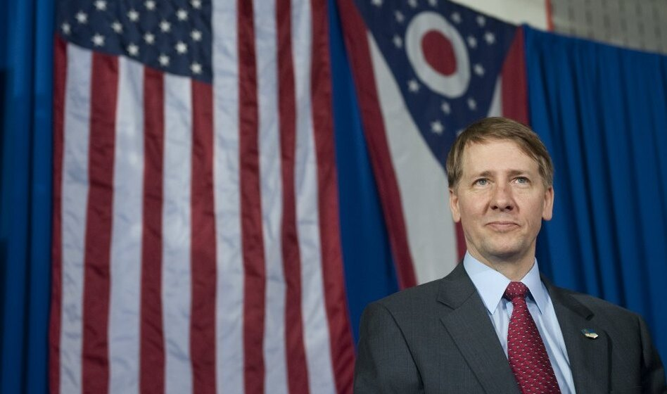 Richard Cordray, incoming head of the Consumer Financial Protection Bureau, stands offstage after President Obama spoke about the economy in Ohio on Wednesday. (Saul Loeb/AFP/Getty Images)