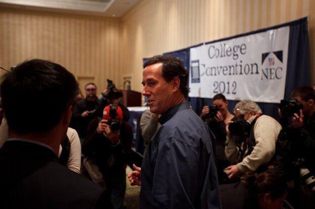 Republican presidential candidate Rick Santorum arrives at the Grappone Conference Center in Concord, N.H., to speak to students from around the country, in an event organized by the New England College.