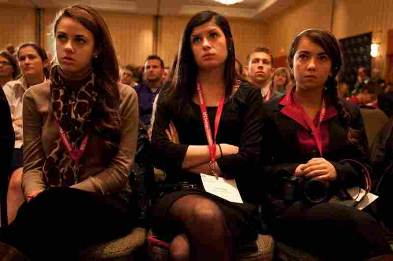 High school students Hannah Carroll, 18, Meghan Corbett, 17, and Leah Campbell, 17, all from Newburyport High School in Massachusetts react to Santorum. Their classmate, Rhiannon Pyle, 17, provoked a heated debate when she asked Santorum a question about his stance on gay marriage.