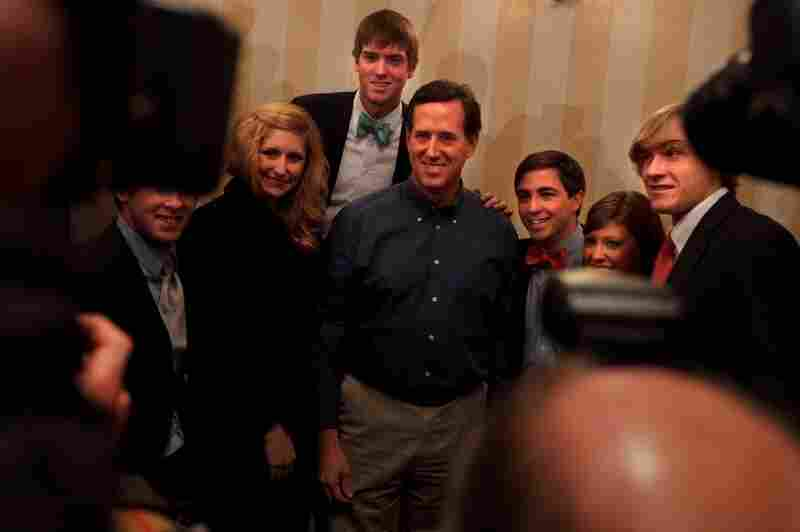 Santorum poses for a picture with supporters after his appearance at the convention.