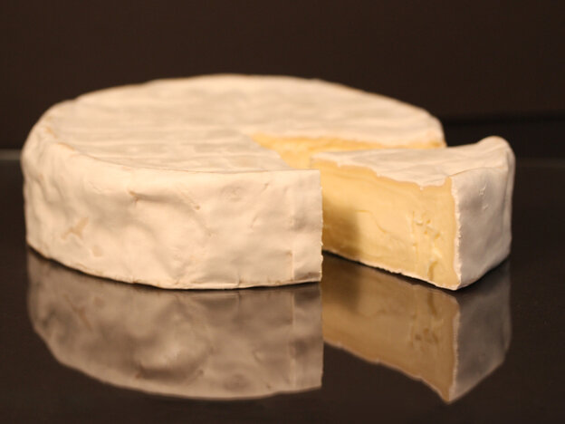 The soft white rind protects and keeps the inside of the cheese clean.