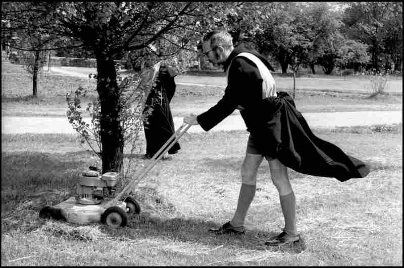 Father Gregory Wilkins, director of The Society of the Sacred Mission, mows the lawn in England, 1963.