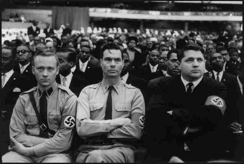 George Lincoln Rockwell (center), founder of the American Nazi Party, is flanked by other members at a meeting, 1961.