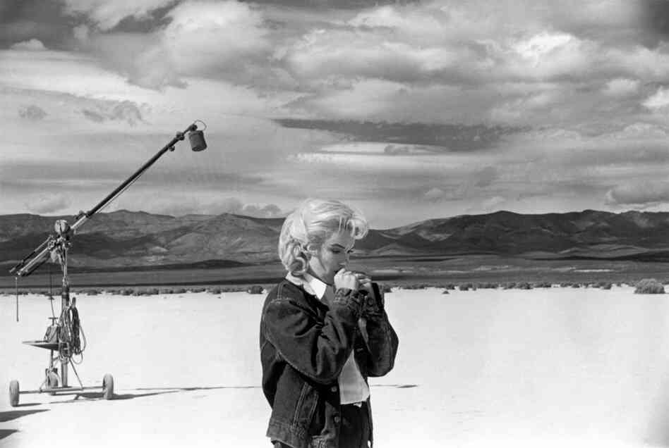 Marilyn Monroe goes over her lines on the Nevada set of the film The Misfits, 1960.