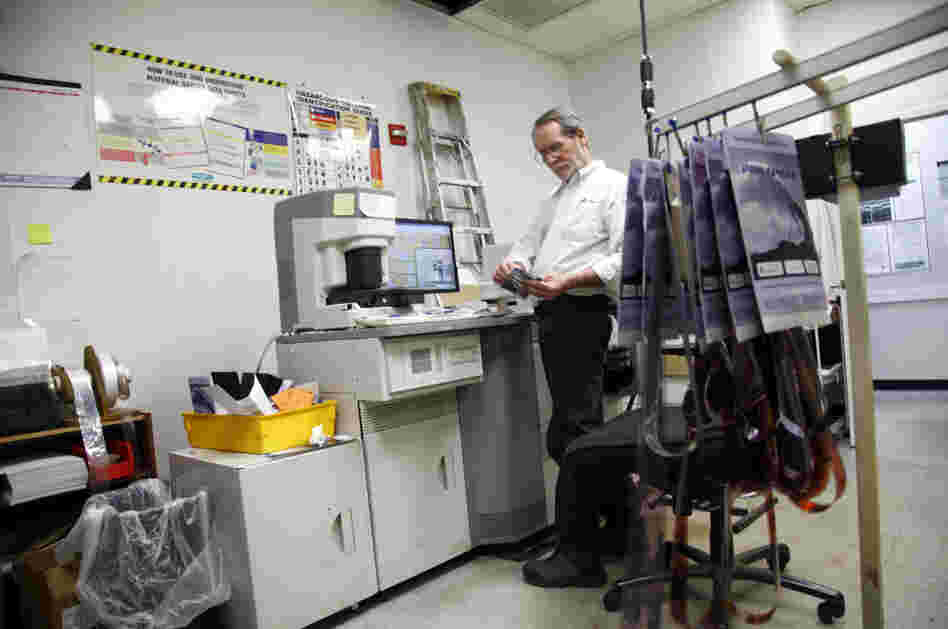 Bill Jonscher works behind the scenes at Penn Camera, processing film and making prints.