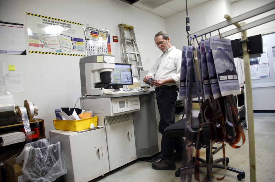 Bill Jonscher works behind the scenes at Penn Camera, processing film and making prints. (Claire O'Neill/NPR)