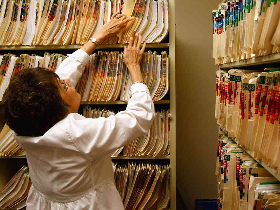 Clinic office assistant Joan Vest searches for a patient's missing medical file at the Spanish Peaks Family Clinic on August 5, 2009 in Walsenburg, Colorado.