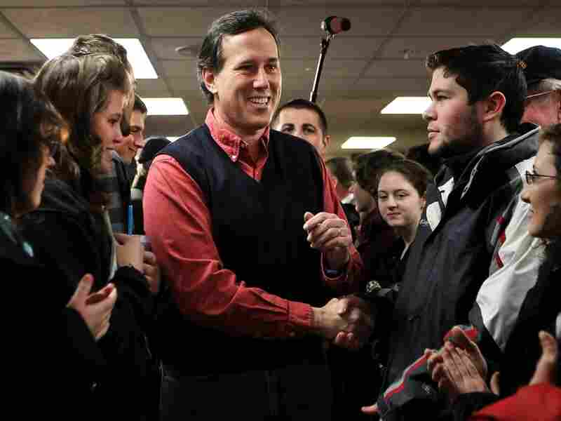 Republican presidential candidate Rick Santorum greets voters as he arrives at a town hall meeting in New Hampshire. Santorum's campaign is looking strong after he finished second in the Iowa Caucus, losing to Mitt Romney by only eight votes.