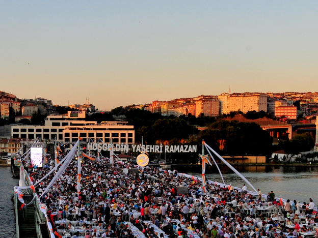 Many Arabs admire Turkey as an Islamic state with a modern economy and a democratic political system. Here, Turks break their fast during the Muslim holy month of Ramadan on a bridge in Istanbul in August.