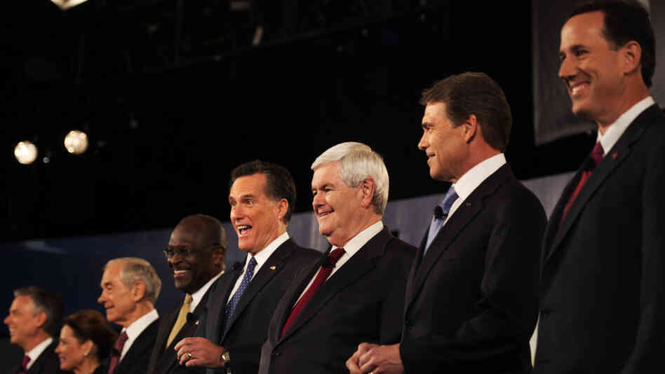Rick Santorum (right) was put on one end of the candidates, Jon Huntsman (far left)