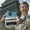 Kodak's Steven J. Sasson holds the world's first digital camera, which he built in 1975, at Kodak headquarters in Rochester, N.Y., in 2005. The company is now trying to sell about a thousand patents for digital photography to prevent bankruptcy.