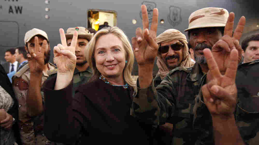 The U.S. is still trying to formulate new policies for the fast-changing politics of the Middle East. Here, Hillary Clinton stands with Libyan fighters who ousted Moammar Gadhafi during an Oct. 18 visit by the U.S. secretary of state to the capital Tripoli.