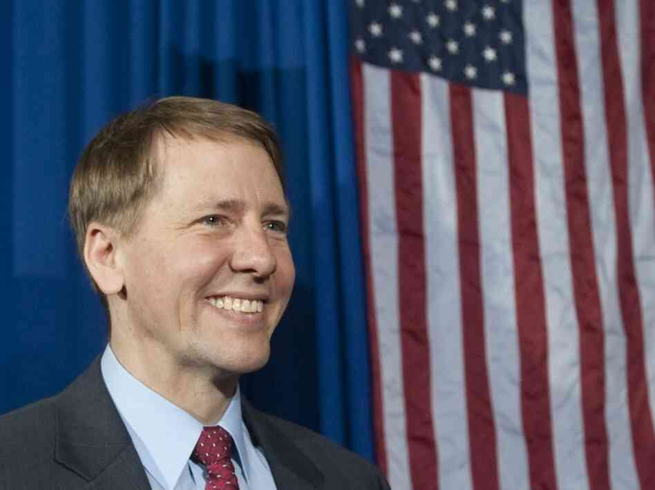 Richard Cordray, incoming head of the Consumer Financial Protection Bureau, stands offstage after President Barack Obama spoke about the economy at Shaker Heights High School in Ohio.